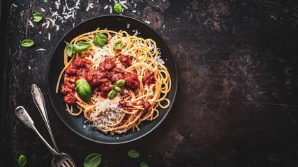 Fototapeta delicious appetizing classic spaghetti pasta with parmesan