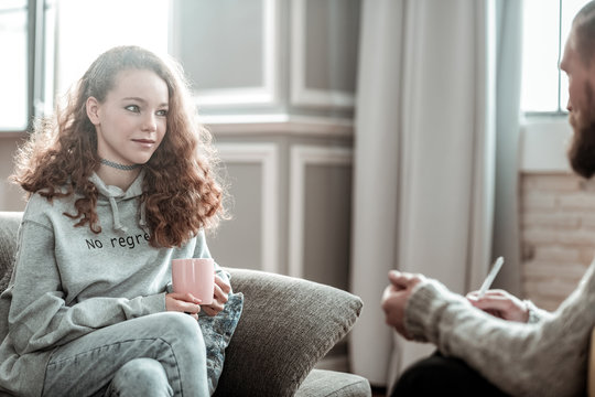 Pleasant appealing teenager feeling relieved during counseling