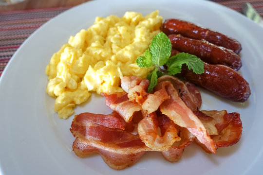 Breakfast Detail With Bacon, Scrambled Eggs, Sausage, and Toast