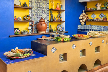 Mexican decorated kitchen. Old fashioned traditional kitchen workplace in Mexico