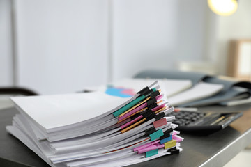 Stack of documents with paper clips on office table. Space for text