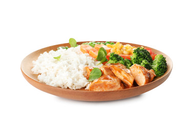 Plate with tasty rice, vegetables and meat on white background