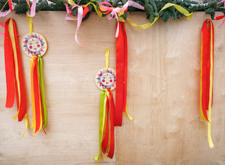 A Christmas tree decorated Shrovetide decorations element with colorful ribbons, fluttering in the wind a picture of the sun as an element of the Carnival celebration