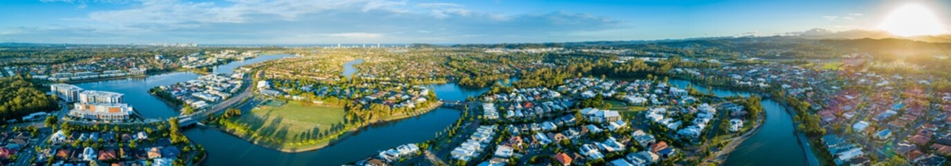 Wide aerial panorama of beautiful sunset over luxury suburb on the Gold Coast, Queensland, Australia - fototapety na wymiar