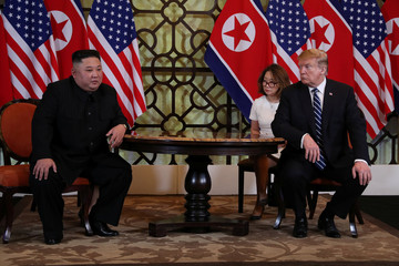 U.S. President Donald Trump looks towards North Korean leader Kim Jong Un during a one-on-one bilateral meeting during the second North Korea-U.S. summit in Hanoi