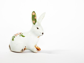 Ceramic rabbit is on white background.