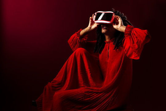 Portrait of a woman sitting and using a virtual reality headset