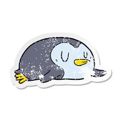 distressed sticker of a cartoon penguin