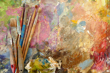 old art brushes on a palette with paints. top view. copy space Wall mural