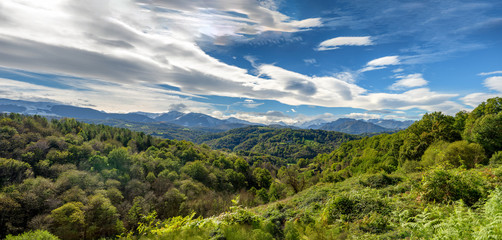 view of the countryside with the Pyrenees mountains in background