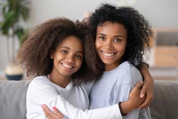 Head shot portrait mixed race girls embracing