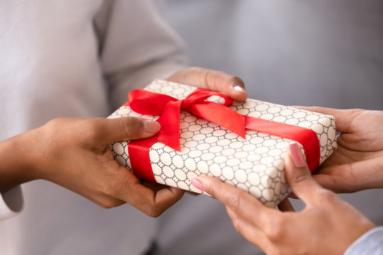 Close up female hands holding gift box