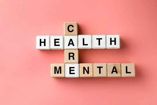 Cubes composed words MENTAL HEALTH CARE on color background