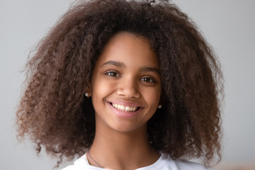 Attractive black teenager girl smiling looking at camera