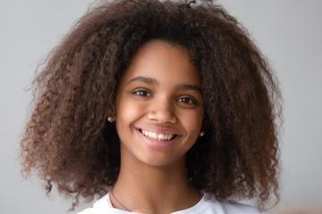 Attractive black teenager girl smiling looking at camera