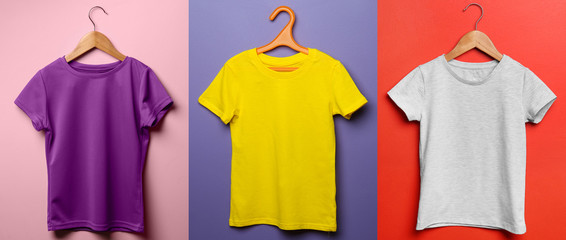 Different child t-shirts on color background Wall mural
