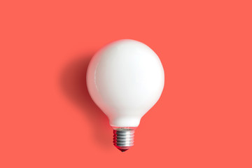 Modern light bulb on color background