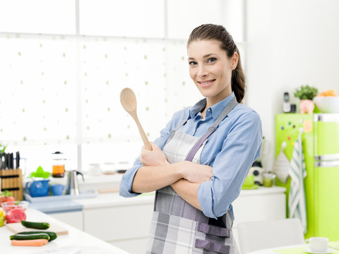 Confident woman posing in the kitchen