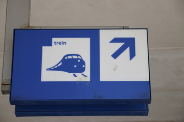 direction sign to the trains at railway station voorburg