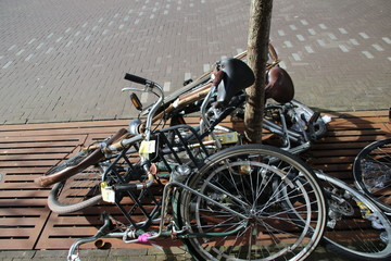 abandoned and old bikes on the street which are marked with label to be removed by the municipality of Den Haag in the Netherlands