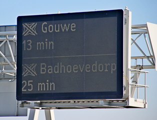 Travel time information dispay to motorway crossing Gouwe and Badhoevedorp on A12 at The Hague