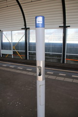 Pole and sign of the smoking zone on a platform where smoking is allowed 3 meters around the pole in the netherlands