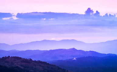 Landscape view of sunrise in early morning on high angle view with misty covered over layers mountain hills at thailand