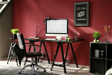 Interior of modern room with stylish workplace