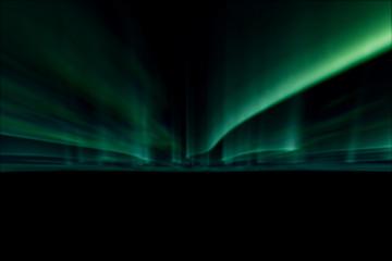 green northern lights against black back ground.