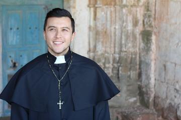 Handsome ethnic catholic priest smiling