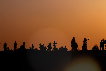 silhouettes of people taking pictures with smartphone