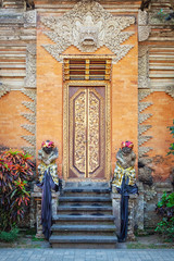 Temple door with statues in Bali Indonesia
