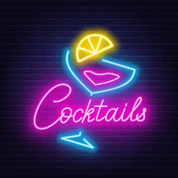 Neon lettering cocktails and sign on wall background.