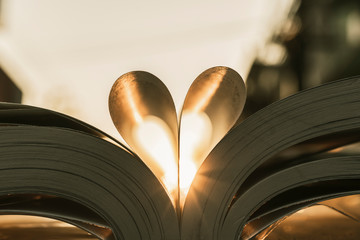 heart shape paper book fold with sun set flare light love ideas concept