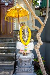 Garland of golden flowers draped around Ganesha