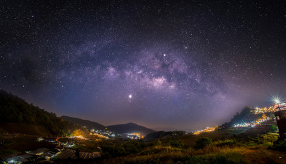 The Milky Way galaxy Up in the dawn on Doi Mon Jam, Chiang Mai, Thailand. Long exposure photograph, with grain.Image contain certain grain or noise and soft focus.