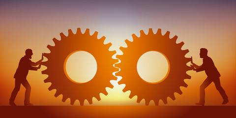 Concept de la collaboration et du partenariat avec deux hommes qui mettent en commun leurs savoirs faire en rapprochant deux engrenages.