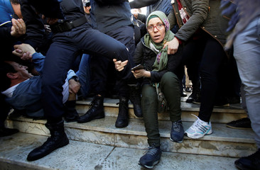 A woman is seen during the journalists protest calling for the right to cover rarely seen anti-government demonstrations, which began a week ago, in Algiers