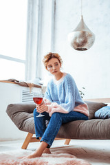 Pleasant good looking woman feeling lonely at home