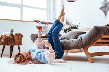 Deurstickers Ontspanning Joyful positive woman enjoying her time at home