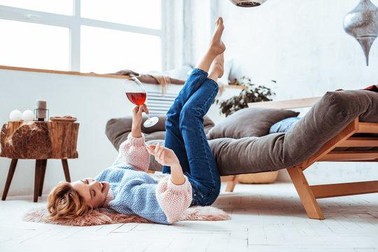 Joyful positive woman enjoying her time at home