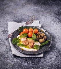 Scallops with sauce, tomatoes and olives on grunge background