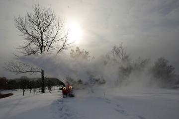 """Chomper,"" a semi-autonomous, GPS-guided snow blower, clears snow in Cambridge"