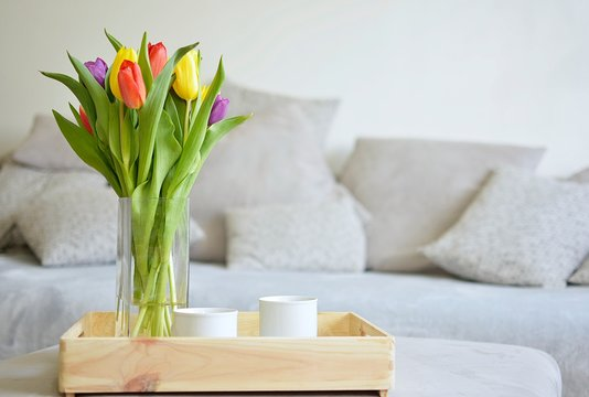 bouquet of tulips on a tray and in the background