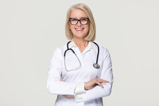 Happy mature woman doctor portrait isolated on grey background