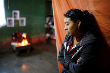 Magdalena Gomez, sister of Felipe Gomez Alonzo, a 8-year-old boy who fell ill and died in the custody of U.S. Customs and Border Protection, stands at her home in the village of Yalambojoch