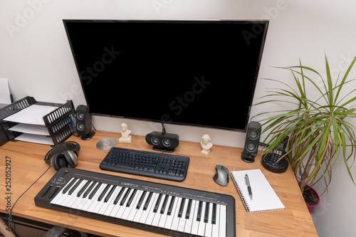 Music workstation with PC, musical keyboard and speakers