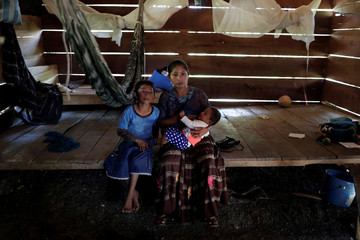 Claudia Maribel Maquin, mother of Jakelin Caal, a 7-year-old girl who died in U.S. custody, poses for a picture with her children inside her house in San Antonio Secortez