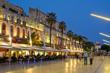 Riva waterfront along the walls of the Diocletian Palace at dusk, Split, Croatia