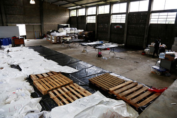 Bodies of victims who died during the eruption of the Fuego volcano are seen at the morgue of Escuintla